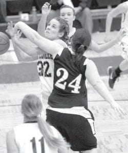 Pettisville's Lauren Frey (32) gets fouled by North Central's Lindsey Newell as Frey drives the lane, Thursday, Jan. 26. The Birds upped their record to 11-4, 6-1 BBC with two victories last week.– photo by Mary Huber