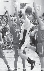 Pettisville's Aaron King splits a pair of Aces to put up a shot, Saturday, Feb. 11.– photo by Mary Huber