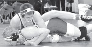 Four Blue Streaks will wrestle at the Division III state meet, Thursday, March 1-Saturday, March 3. Above, Austin Ripke, a senior, works to tilt Elmwood's Jake Wise in the district semifinals. Ripke won the district championship in the 160-pound weight class. The Blue Streaks also won the team championship.– photos by Mario Gomez