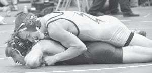 Drew Coffey, a sophomore, works for position against Woodmore's Evan Ulinski in the quarterfinals. Coffey finished second in the 106-lb. weight class.