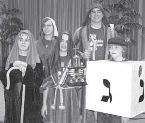 """TheZionBiblequizteam,""""AmIaJew?""""hadalotoffun dressing up as Biblical Jews for team spirit week. It won all four of its matches, averaged 130 points, and took home one of the traveling trophies, Sunday, Feb. 26. The team was also chosen as one of the spirit week award winners. Members are, from left: Nathan Yoder, Hannah Short, Ben Zimmerman, Zach Zimmerman, Cameron Short. Team coaches are Ben Frey, Sue and Stan Short.– courtesy photo"""