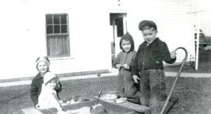 An afternoon playing in the sandbox was a treat for friends at the Ralph Peters residence in the Lugbill Addition beside his veterinary office in the 1940s. From left are Karen Peters, Dee Ann Rupp, David Rupp, and Meryl Nofziger.– Antique photograph from the collection of Ruby Short, submitted by Sally Short Collamore
