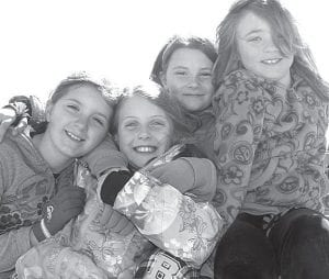 After weeks of spring- and summer-like temperatures, Monday, March 26 was chilly, with a high of just 51 degrees. That didn't stop youngsters at Archbold Elementary School from outdoor recess. Carsyn Hagans, Karli Luderman, Emma Hall, and Kaity Schnitkey, from left, were suitably bundled for their outdoor play period.– photo by David Pugh _________________________