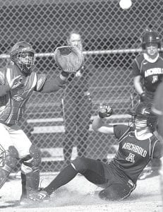 Becca Gerig beats the throw to home plate and scores a run in the second inning of Archbold's 11-1 victory over Edon, Tuesday, March 27.– photo by Mary Huber