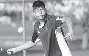 Antonio Cuellar hits a forehand.– photo by Mary Huber