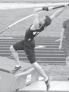 Justin Pursel plants his pole for an attempt in the pole vault, Tuesday, April 3. The PHS junior finished second in the event. photo by Jack Frey