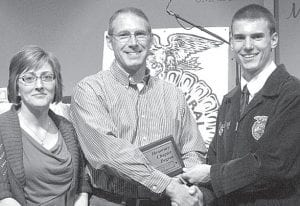 Justin Pursel, new Pettisville FFA president, congratulates Peggy and Jack Kruse, Honorary Degree members.– courtesy photo