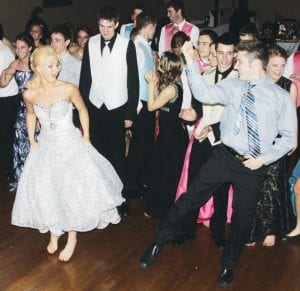 Leading the dancing are Kaylee Dougherty, a PHS senior in the white dress at left, and Trey Rupp, in the gray shirt at right, a junior from Wauseon.– photos by David Pugh