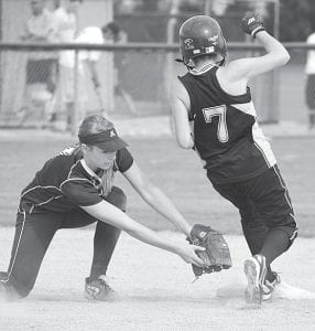 The tag of Blue Streak shortstop Becca Gerig is too late, and a Fairview Apache steals second base in the third inning of their non-league contest, Friday, April 13. AHS won the contest 1- 0.– photo by Mario Gomez