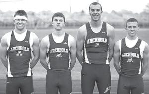 The boys 4x200 relay team of Danny Young, Levi Wyse, Hayden Stamm, and Jacob Ott set a meet record at the Napoleon Invitational. Young also set a meet record in the 300-meter hurdles.– photo by Donald Young