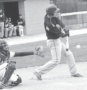 Zach Pursel hits an infield base hit in the second inning of Pettisville's non-league contest with Archbold, Wednesday, April 11. With the score tied at 2, the Birds scored the winning run in the seventh inning for a 3-2 victory.– photo by Mario Gomez