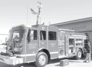 The newest addition at the Archbold Fire Department, a new Engine 102, arrived Friday, April 13. The German Township Trustees purchased the vehicle at a cost of $461,984, which included the cost of most of the equipment to outfit the vehicle. The tall tower on the truck cab is a remote-controlled floodlight system, which can rotate and tilt to light a dark accident scene.– photo by David Pugh
