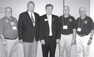 Jerry Rohrs, Archbold, right, was named the Zone 1 Lion of the Year at the Lions International District Convention in Findlay, Saturday, March 31. The award recognizes Rohrs' dedicated service to Lions of District 13A, which includes Fulton and Williams counties. Gene Spiess, center, a former Archbold resident and member of the AHS class of 1960, is one of 34 worldwide directors for Lions International. Spiess, who resides in Spartenburg, S.C., was the keynote speaker at the convention. From left: Gene Grime, Napoleon Lions; Ron Hausch, West Unity Lions and a classmate of Spiess; Spiess; Karlin Wyse, Archbold Lions; and Rohrs.– courtesy photo