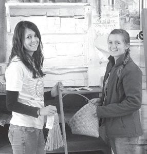 Pettisville High School seniors spent Monday, April 23, working at Sauder Village for their annual Senior Service Day. Students helped Village staff prepare for the coming season. Above, seniors Kasey Frey, left and Emily Borton worked in the Village Trader building in the Natives & Newcomers area.– courtesy photo