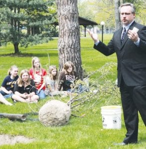 Jim Wyse, village mayor, talks to the students about the history of Arbor Day in Archbold. During the ceremony, students observe and assist with the planting of a tree. The ceremony is one of the requirements the village must fulfill to be named a Tree City, USA, by the Arbor Day Foundation. Archbold has held the title for 29 years.– photos by Mary Huber