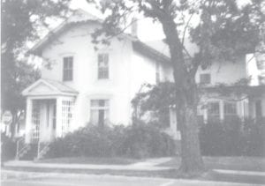 Frederick Stotzer, harness maker and first mayor of Archbold, built this house in the 1890s. Ora E. Lauber, owner of Lauber Clothing, lived in the house longer than anyone with his son's family, William and Velma Lauber and their son Jack. The Farmers & Merchants State Bank bought the property at public auction in 1977, razed the house, and developed what is now known as the Village Green at the corner of West Holland and Ditto streets. Ora's brother, Edward, lived next door to him on Ditto Street and another brother, Harry, lived at the southwest corner of West Holland and Ditto streets, today a public parking lot.– Antique photograph from the collection of Les Gericke