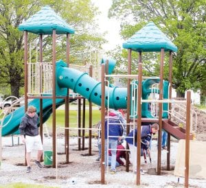 Barry Ranzau, chairman of the Ridgeville Township Park Board, said 32 volunteers gathered at the park, Saturday, April 21, to install new playground equipment. The board raised about $25,000 in private donations to pay for the project. Ranzau said Monday, when he removed the caution tape from the equipment, there were children on hand ready to try out the new playground. The next project for the board is to raise donations for a new shelterhouse and combination tennis-basketball court.– photo by David Pugh