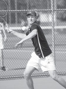 David Lauber keeps his eye on the ball and returns a forehand in AHS tennis action last week. He and Bryce Tinsman, his doubles partner, were victorious in all of their matches last week.– photo by Mary Huber