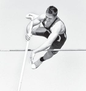 Darin Sauder clears the bar in the pole vault relay.– photos by Donald Young