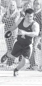 Travis Jaramillo winds up for an attempt in the discus throw relay.