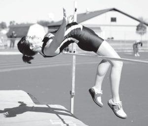 Rachel Wiemken contorts her body for a clean jump in the high jump relay.