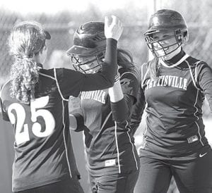 Lexie King (25) and Adi Bruner, right, congratulate Taylor Kruse as the senior crosses home plate after hitting a three-run home run against Hilltop, Thursday, April 26.– photos by Mary Huber