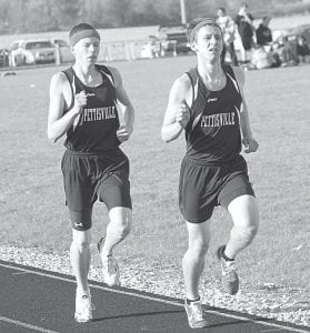 Tim Iott, left, finished second and Dominic Frey, right, was third in the 3200 in Pettisville's tri-meet with Hilltop and Stryker, Tuesday, April 24.– photos by Jack Frey