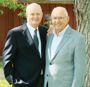 Dean Spangler, left, former chief executive officer of Spangler Candy Company, Bryan, has been named chairman of the board of Sauder Village. He replaces Maynard Sauder, right, former Sauder Village board chairman. Spangler is the first man outside the Sauder family to lead the living-history museum.– courtesy photo