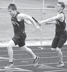 Caleb Yoder takes the handoff from Justin Pursel in the 4x100 at Pettisville's quad meet with Edon, North Central, and Stryker, Tuesday, May 1. The Blackbirds won the race.– photo by Jack Frey