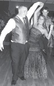 """It was a dancing crowd at the 2012 Archbold High School Prom, Saturday, May 12, at the Archbold Knights of Columbus Rebeau Hall. The theme was """"Arabian Nights."""" Left: Jacob Fleischman, an AHS senior, and Maddy Short, a junior, step to the music. Right: McKenzie Yoder, a junior and Pond Assavasoth, a senior international student from Thailand, are all smiles while sharing a dance.– photos by David Pugh"""