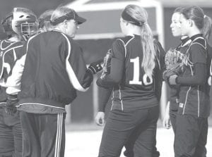Kendra Stahl, PHS head softball coach, talks to the infield during a time-out.– photo by Mary Huber