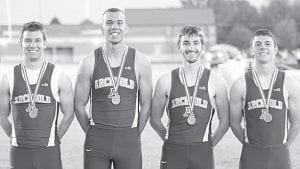 From left: Danny Young won the 300-meter hurdles, Hayden Stamm won the 400, Dean Herrett won the pole vault, and Levi Wyse won the 100 at the Northwest Ohio Athletic League meet last week.– photo by Donald Young