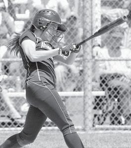 Chelsea Goebel hits a double to right field in the sixth inning of Archbold's Div. III district final with Ottawa-Glandorf. Goebel scored on the next play when Cassidy Wyse hit a double, giving the Streaks an 8-0 lead. AHS won 9-3 to advance to the regional.– photo by Mary Huber