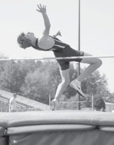 Blake Drewes finished fourth in the high jump to advance to the Div. II regional meet. He was also on the winning 4x400 team.– photo by Donald Young