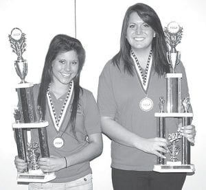 Caroline Vonier, left, and Morgan Hausch, Archbold students attending the Four County Career Center, earned the right to advance to Family, Career and Community Leaders of America (FCCLA) national competition in Orlando, Fla., July 6-12. They earned a spot in nationals by obtaining a gold or silver rating at FCCLA state competition in Columbus. Vonier and Hausch are two of five FCCC students, all from the interior design program, who advanced.– courtesy photo