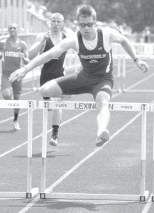 Danny Young clears a hurdle in the 300-meter hurdles at the Div. II regional track meet. Young is the first Div. II AHS regional track and field champion in school history.– photo by Donald Young