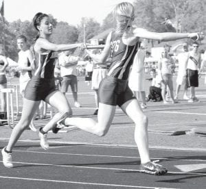 Angelica Reyes hands the baton off to Kassidy Garrow in the 4x400. The Streaks advanced to state with a second-place finish at the Div. III regional meet.– photo by Jack Frey