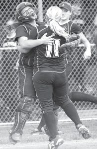 Catcher Ruth Beck and pitcher Hanna Allison celebrate after the Streaks slipped past Evergreen 4-3 in the Div. III regional softball semifinal, Wednesday, May 23. Cassidy Wyse, in the background, fielded a ground ball and got the third out in the seventh to prevent the Vikings from tying the score.– photo by Mary Huber
