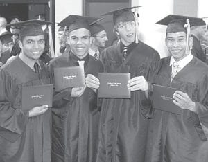 Four of the newest Archbold High School alumni show off their diplomas after graduation ceremonies, Sunday, May 27. From left: Kevin Baez, Christian Baez, Blake Drewes, and Adrian Ramirez. More than 100 diplomas were issued.– photo by David Pugh