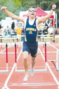Blue Streak senior Danny Young raises his arms in triumph after winning the Div. II state championship in the boys 300-meter hurdles, Saturday, June 2, in Columbus. It is Young's second state title; he was also on the 4x200-meter relay team that won a Div. III state title in 2010. For more coverage on the state track and field meet, see pages 6 and 7.– photo by Jack Frey