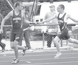 Hayden Stamm, left, takes the handoff from Jacob Ott in the boys 4x200 preliminaries at the Division II state track and field meet, Friday, June 1, in Columbus. The top nine finishers advanced to the finals; the Streaks finished 10th.– photo by Jack Frey