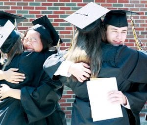 Kelsey Waidelich, left, and Zach Kempf hug fellow graduates after Pettisville High School commencement exercises, Sunday, June 10. The Class of 2012 was the first to graduate from the new school.– photo by Mary Huber