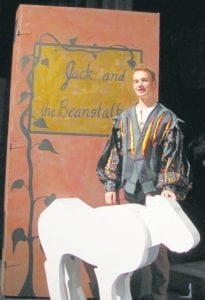"""Caleb Wyse with the wooden cow he has to """"lug around stage"""" for the Archbold Community Theatre production of """"Into the Woods."""" Wyse plays Jack, from the fairy tale, """"Jack and the Beanstalk,"""" one of four fairy tales intertwined in the show.– courtesy photo"""