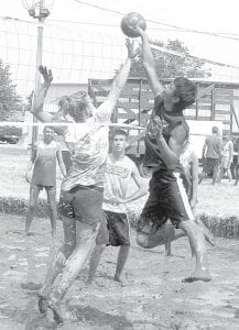 Oozeball, volleyball played in mud, has been part of the annual Black Swamp Benefit since 2005. This year's tournament was Saturday, June 16, and included teams from the Archbold and Pettisville areas.– photo by David Pugh