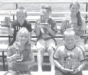 Pedal tractor pull winners at Pettisville Friendship Days, Saturday, June 23, were, front row from left: Claire Nisely, Division 1, ages 5 and under; Caleb Grieser, Division 2, age 6-7. Back row: Landon Nisely, Division 3, ages 8-9; Joel Flory and Mikayla Graber, Division 4, ages 10-11. Missing: Braden Burkholder, Division 1, 5 and under; Gabriel Stefanelli, Division 2, ages 6-7. The Pedal pull is co-sponsored by the Pettisville FFA and FFA Alumni.– courtesy photo