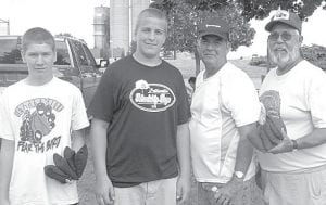 Winners of the double-elimination cornhole tournament at Pettisville Friendship Days, Saturday, June 23, were, from left: Dustin Nofziger and Tyler Herschberger, junior division; Rod Gilbert and Gary Reamsnyder, senior divison.– courtesy photo
