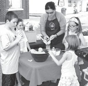 Katie and Lydia Whiteman sold lemonade at the Archbold Farmers Market, Thursday, July 5, to raise money for a mission trip to India. From left are Reed Krueger, 9; Kate Krueger, 7; Katie Whiteman; Lydia Whiteman, 7; and Elizabeth Whiteman, 5 1/2. All are from Archbold.– photo by Mary Huber