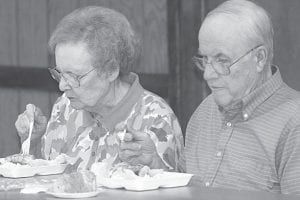 Wayne and Ruth Rupp, Pettisville, enjoy the fish dinner at the Friday night Lions Club Fish Fry.– photo by Mary Huber