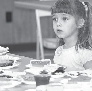 Evynn Roth, 4, Archbold, decides what kind of pie she wants for dessert at the Lions Club Fish Fry Friday night.– photo by Mary Huber
