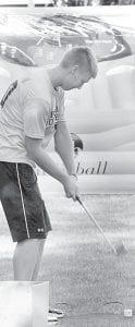 Garrett Morton, AHS '11, plays Birdieball at the 2012 Archbold Carp Festival.– photo by Mary Huber